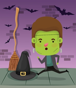 Little boy with costume of frankenstein and witch hat
