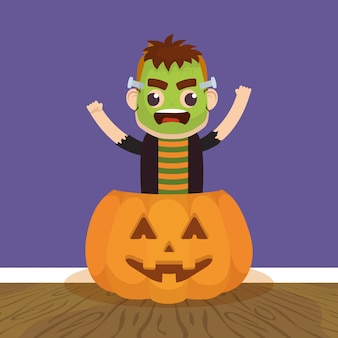 Little boy with frankenstein disguise in pumpkin