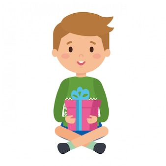 Little boy with winter clothes and gift