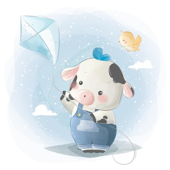 Little calf boy playing a kite