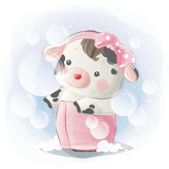 タオルで小さな子牛の女の子