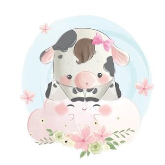 かわいい雲の上に座っている小さな子牛の女の子