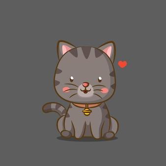 Маленький кот с колокольчиком на ожерелье и милое сидение на лице