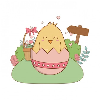 Little chick with egg broken in the garden easter character