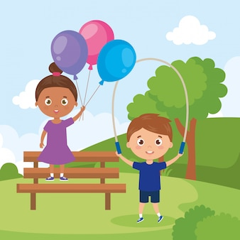 Little children with balloons helium and rope jump in park landscape
