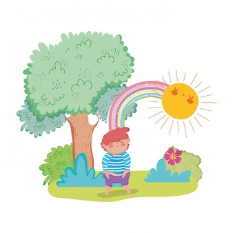 Little chubby boy with rainbow in the landscape