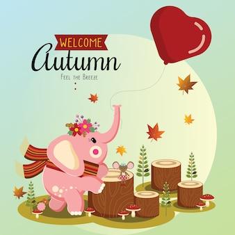 Маленький слон, играющий осенью