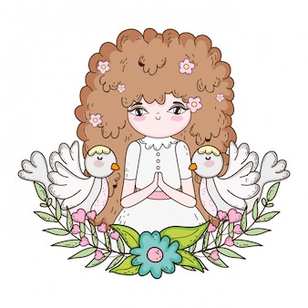 Little girl and doves in first communion celebration