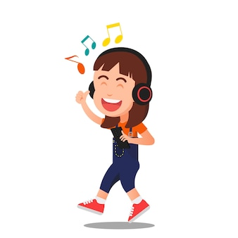 A little girl happily listening to music