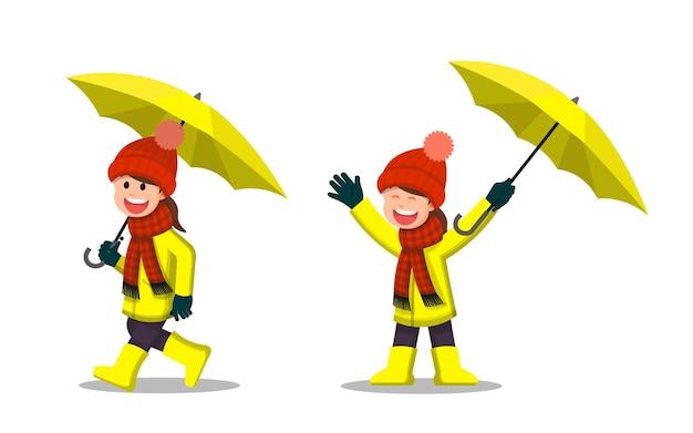 傘を持っている冬の服を着た少女