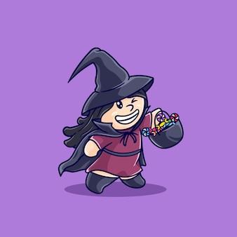 Маленькая девочка в костюме ведьмы приносит конфеты на хэллоуин