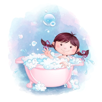 A little girl is having fun bathing in a pink bath with soap foam and bubbles.