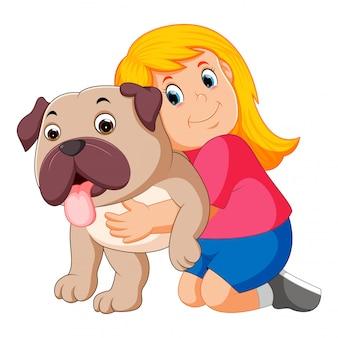 Little girl is hugging dog