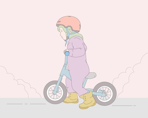 自転車に乗る女の子子供。プレミアム