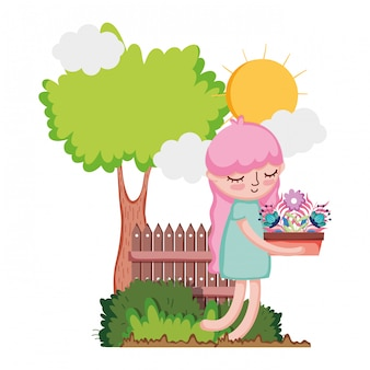 Little girl lifting houseplant with tree and fence