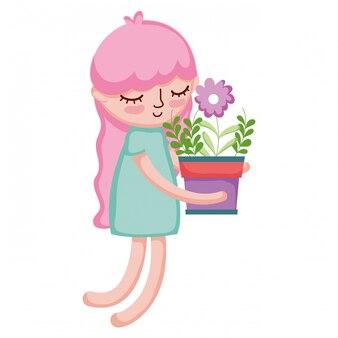 観葉植物を持ち上げる少女