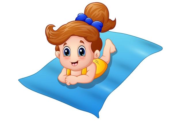Little girl lying on the mats