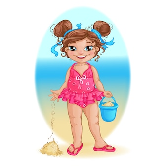 Little girl in pink swimsuit plays on the beach with a bucket.
