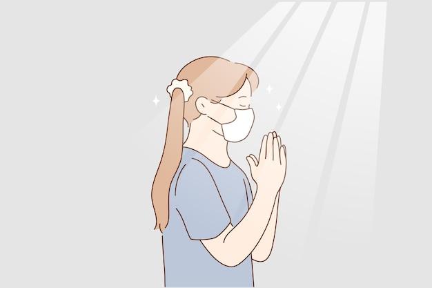 Маленькая девочка молится дома во время концепции пандемии