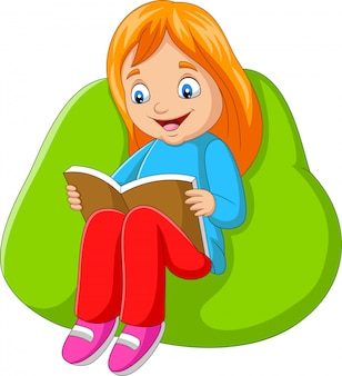 Little girl reading a book sitting on big pillow