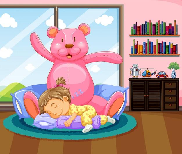 ピンクのteddybearで眠っている少女