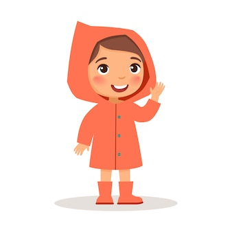 Little girl standing in a coral raincoat and rubber boots.
