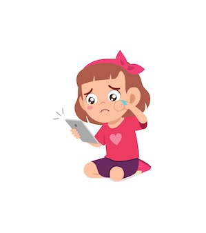 Little girl using mobile phone and cry