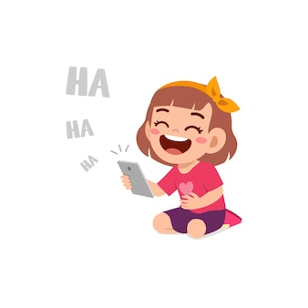 Little girl using mobile phone and laugh