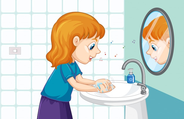 Маленькая девочка моет руки в раковине