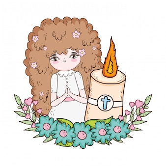 Little girl with candle in first communion celebration