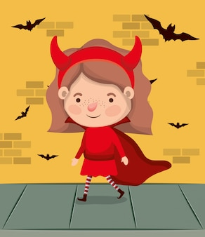 Little girl with devil costume and bats flying in wall