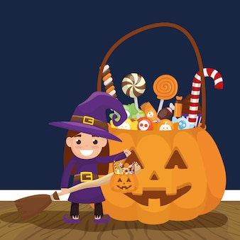 Little girl with witch disguise and candies pumpkin