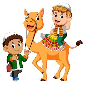 Little kid riding camel