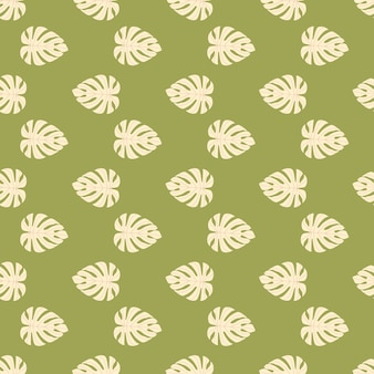 Little light pink monstera leaf ornament seamless pattern. exotic foliage ornament on green background.