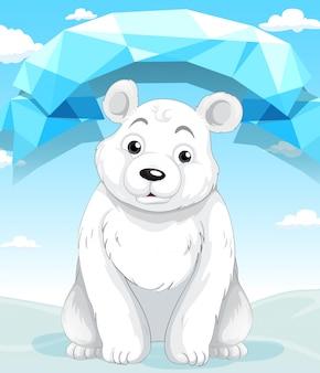 Маленький белый медведь сидит на льду
