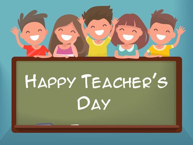 黒板に小さな小学生。幸せな先生の日