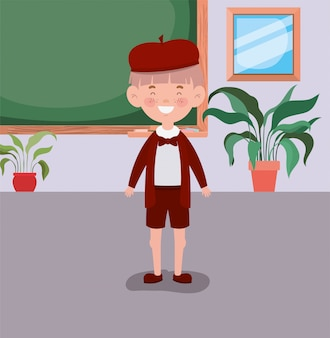 Little student boy in the classroom