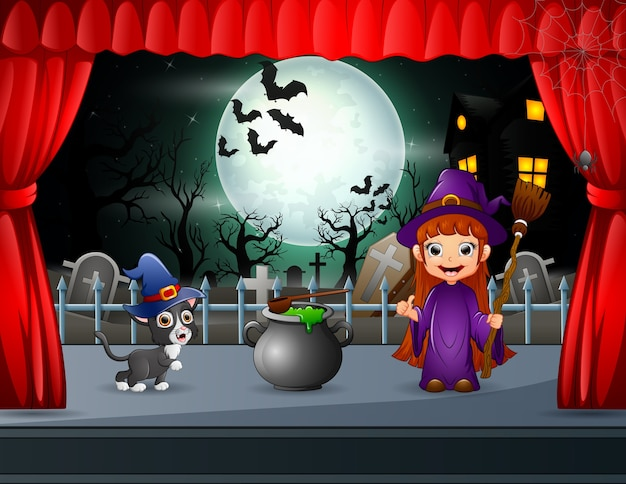 Little witch and black cat performing on stage