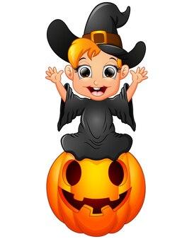 Little witch cartoon sitting on the pumpkin