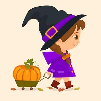 Little witch rolls a cart with pumpkin