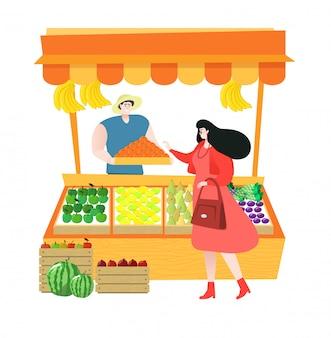果物を売る地元の農産物市場の果物屋が、果物を販売し、顧客が新鮮な果物を買い物しています。