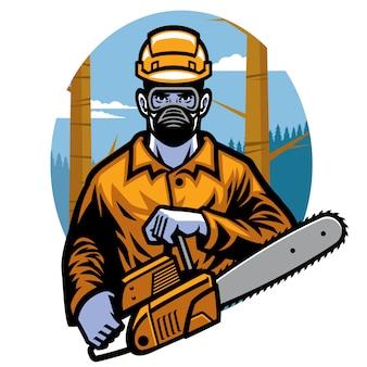 チェーンソーを保持している伐採労働者