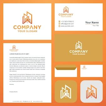 Логотип здание или недвижимость на визитной карточке премиум векторы премиум логотип
