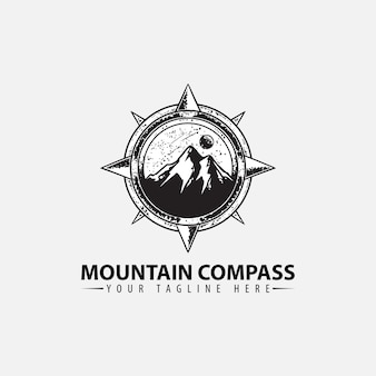 Logo with mountain and compass design template Premium Vector