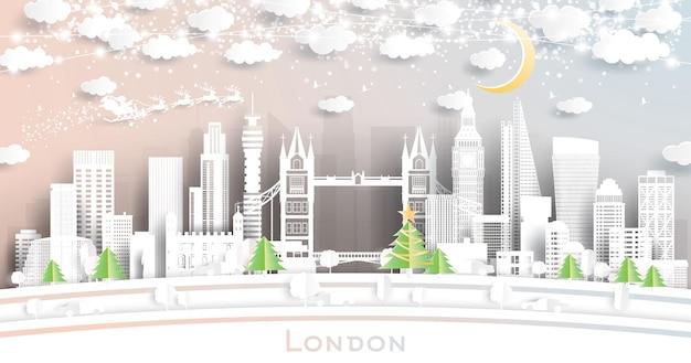 Лондонский городской горизонт англии в стиле вырезки из бумаги со снежинками, луной и неоновой гирляндой. векторные иллюстрации. рождество и новый год концепция. дед мороз на санях.