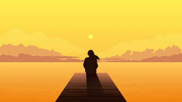 Lonely girl silhouette on sunset. sad alone dreamy woman sitting looking at orange sunset.