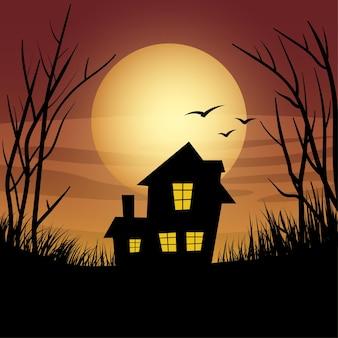 실루엣에 새 잔디와 나무와 외로운 집 일몰
