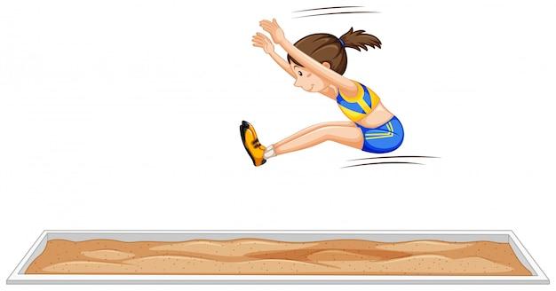 La ragazza di salto in lungo che salta nell'evento sportivo