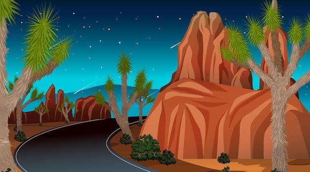 Long road through the desert landscape scene at night