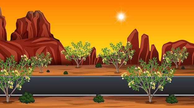 Long road through the desert landscape scene at sunset time